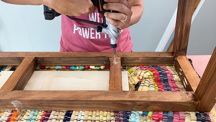 Attaching the upholstered top to the DIY bench frame