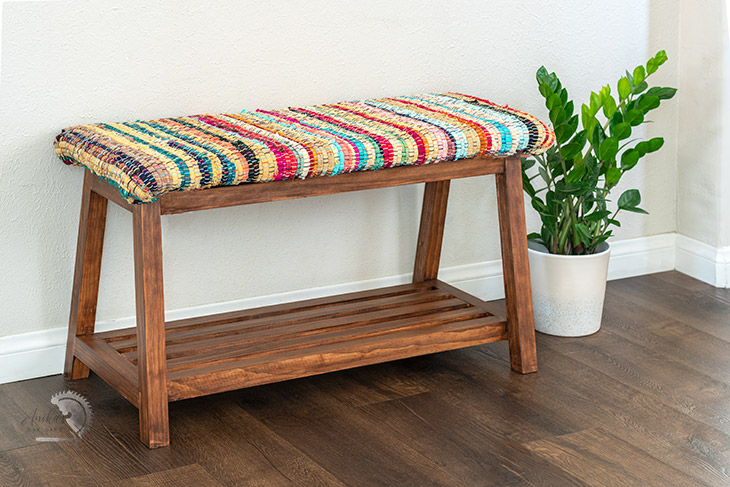 DIY upholstered bench with colorful fabric in room