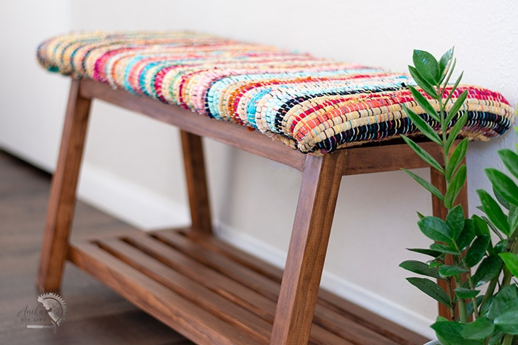 close up of the fabric of the diy bench with shoe storage