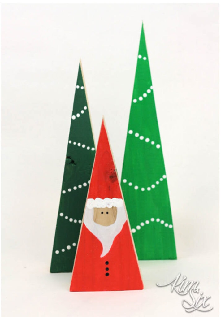 2 triangle scrap wood trees and a triangle scrap wood santa