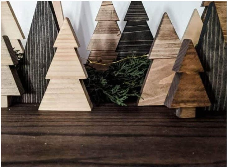 Scrap wood cut into the shape of Christmas trees and stained
