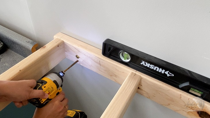 Attaching brace for DIY floating shelf to the wall using strong screws
