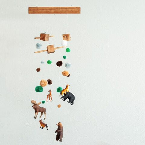 How to make a DIY baby mobile. Step by step tutorial and video for woodland themed nursery decor. #woodworking
