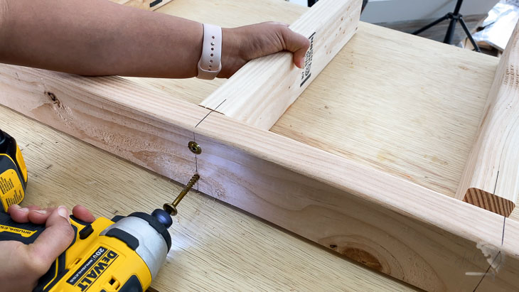Attaching 2x4s using structural screws to make the DIY floating shelf