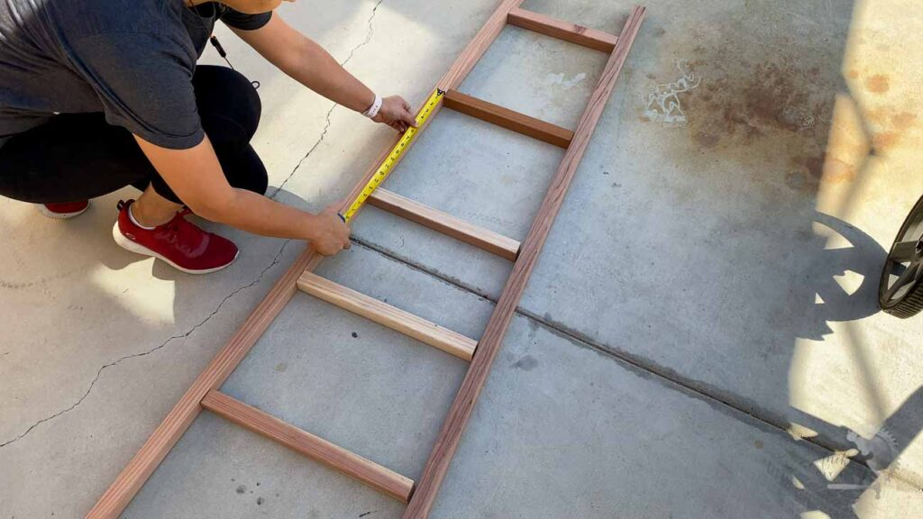 Laying out the boards for the DIY blanket ladder