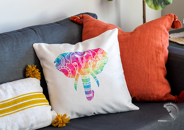 Pillow made with colorful influsible ink on couch