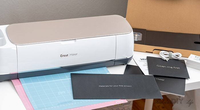 Cricut Maker on desk with everything included in the box