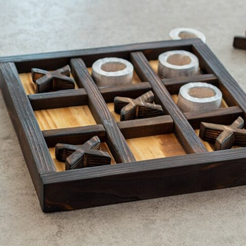 DIY wooden Ti-Tac-Toe game on a coffee table