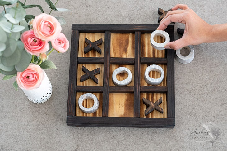 Woman playing tic-tac-toe on a coffee table