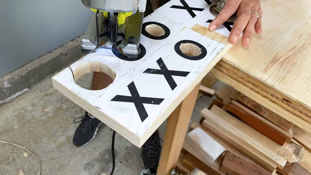 Cutting the X and O for the DIY wooden Tic Tac Toe game using a jigsaw