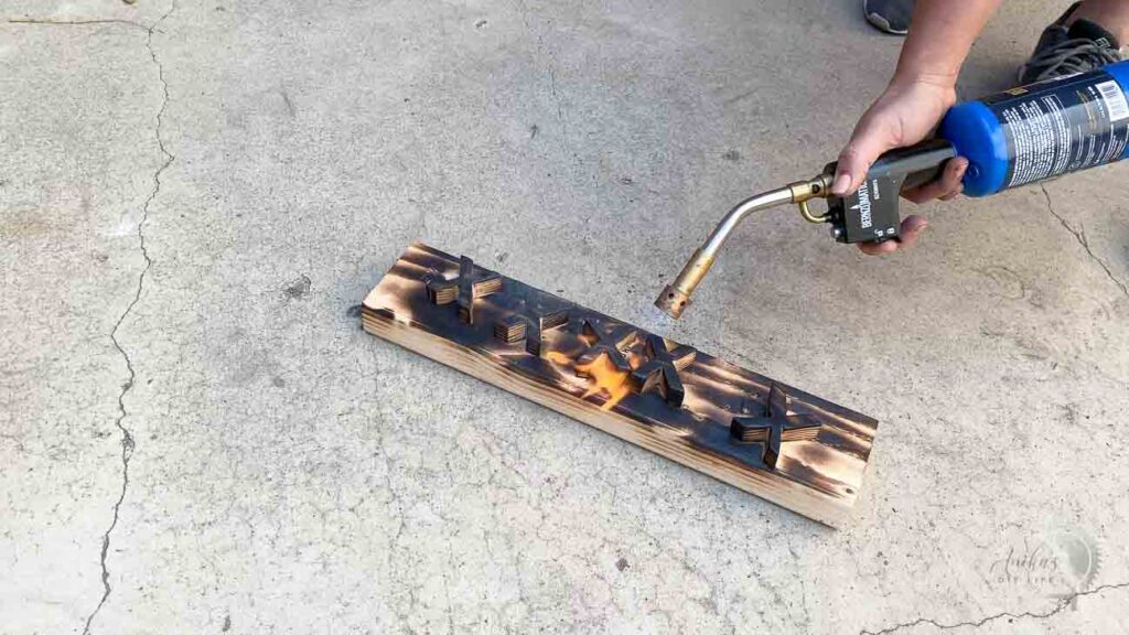 Torching the X and O using a propane blow torch