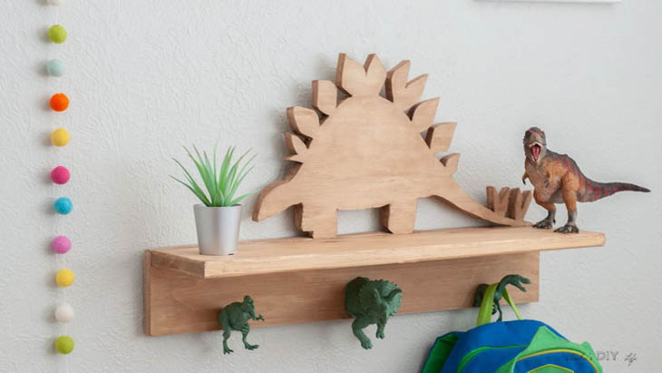 DIY wood dinosaur shelf with dinosaur figures as hooks