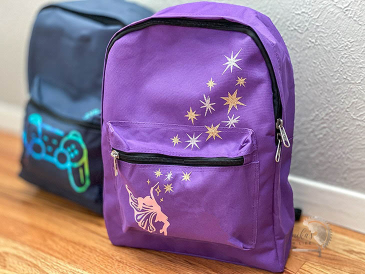 blue and purple kids backpacks with iron on custom designs