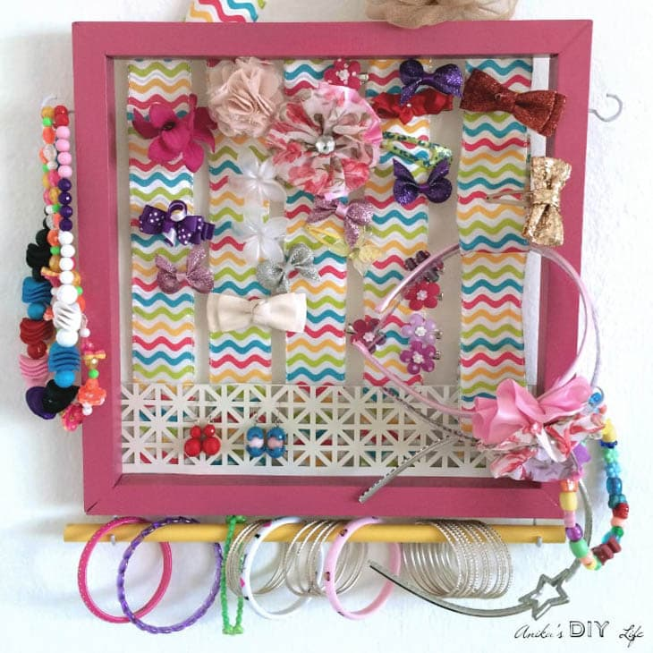 DIY girl's accessory holder painted pink with jewelry and hair accessories