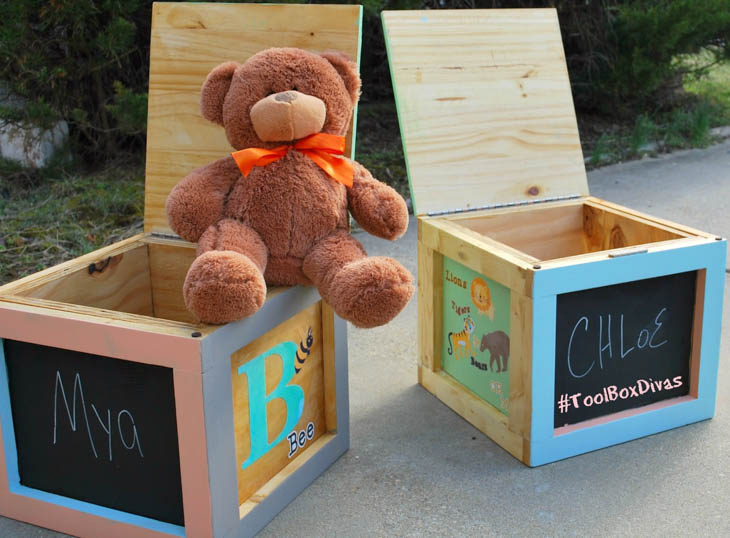 DIY wood kids storage boxes with alphabet letters painted on them and a teddy bear sitting on one