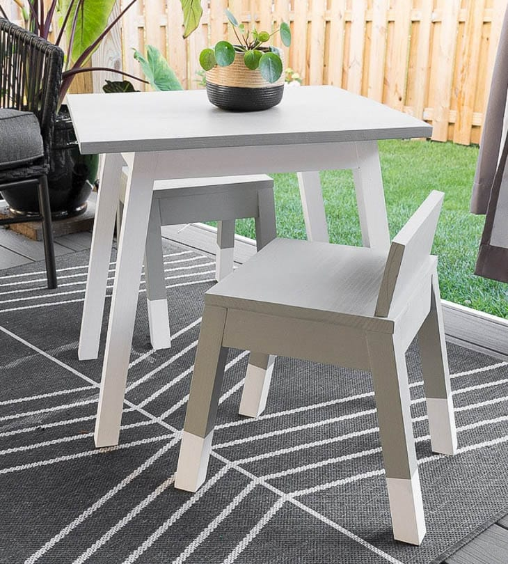 Gray painted kids angled leg chair with white block painted legs