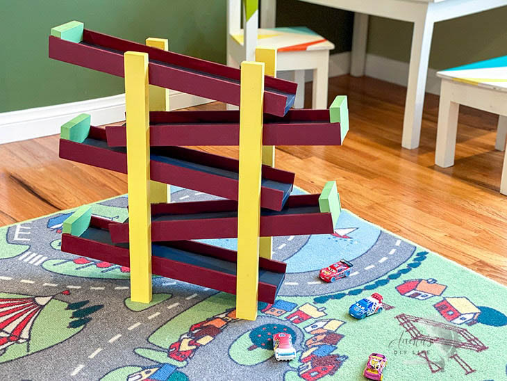 DIY kids toy car ramp painted burgandy and yellow