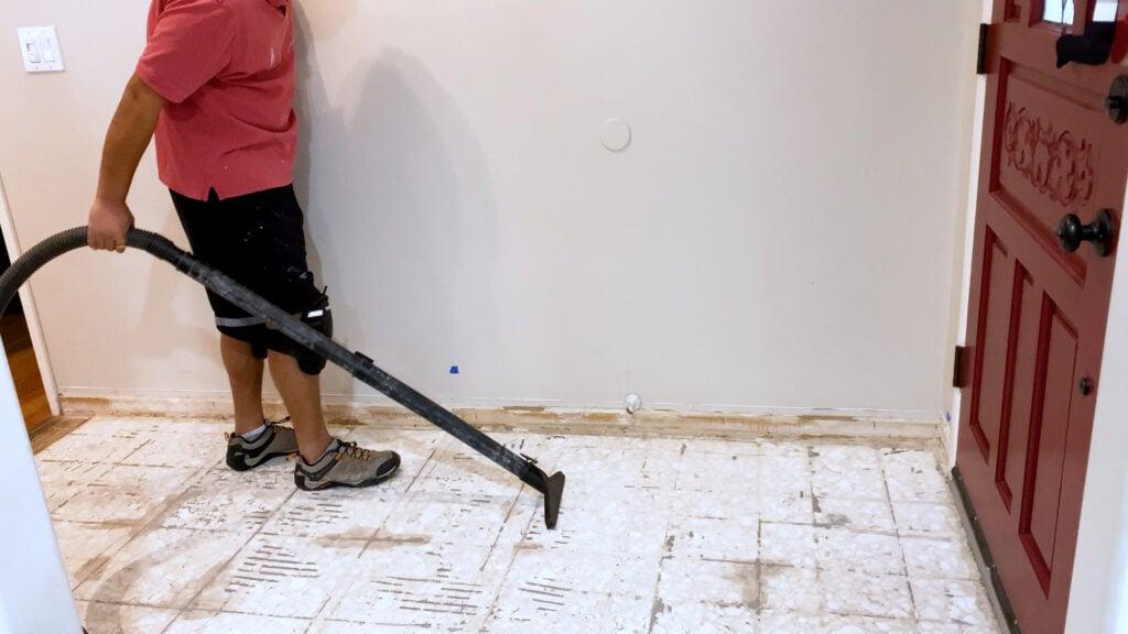 vacuuming the floor before installing vinyl plank flooring