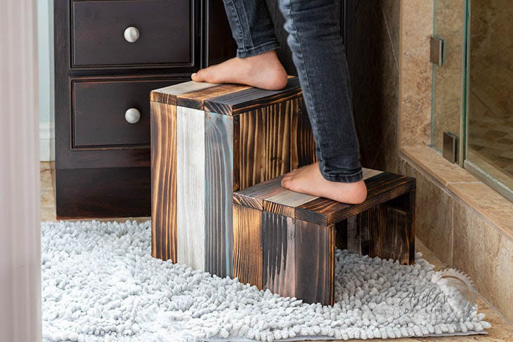 DIY wooden step stool with kid standing on it