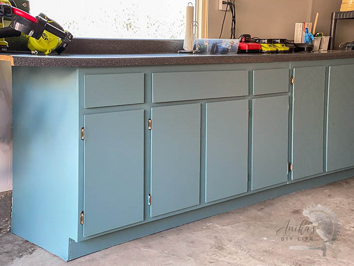 blue painted cabinets in a garage
