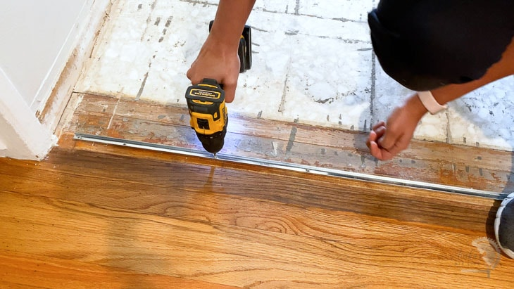 installing metal strip for transition with vinyl plank flooring