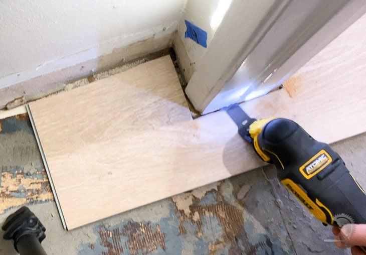 Cutting under a door jamb to install vinyl plank flooring