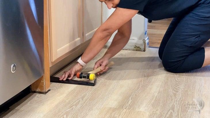 installing the last row of vinyl plank flooring using an S-bar