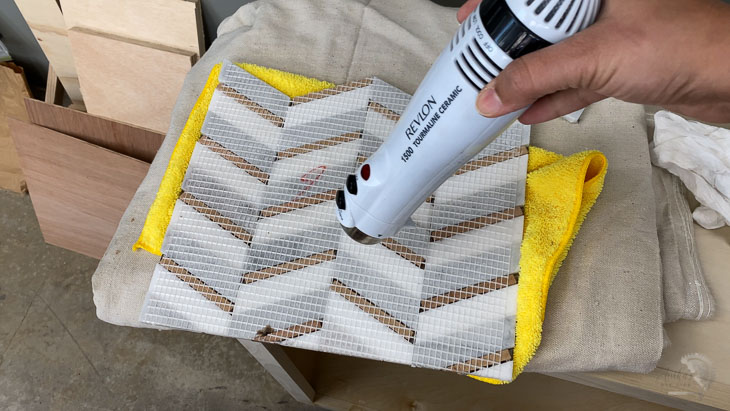 drying the mosaic tile using a hair dryer