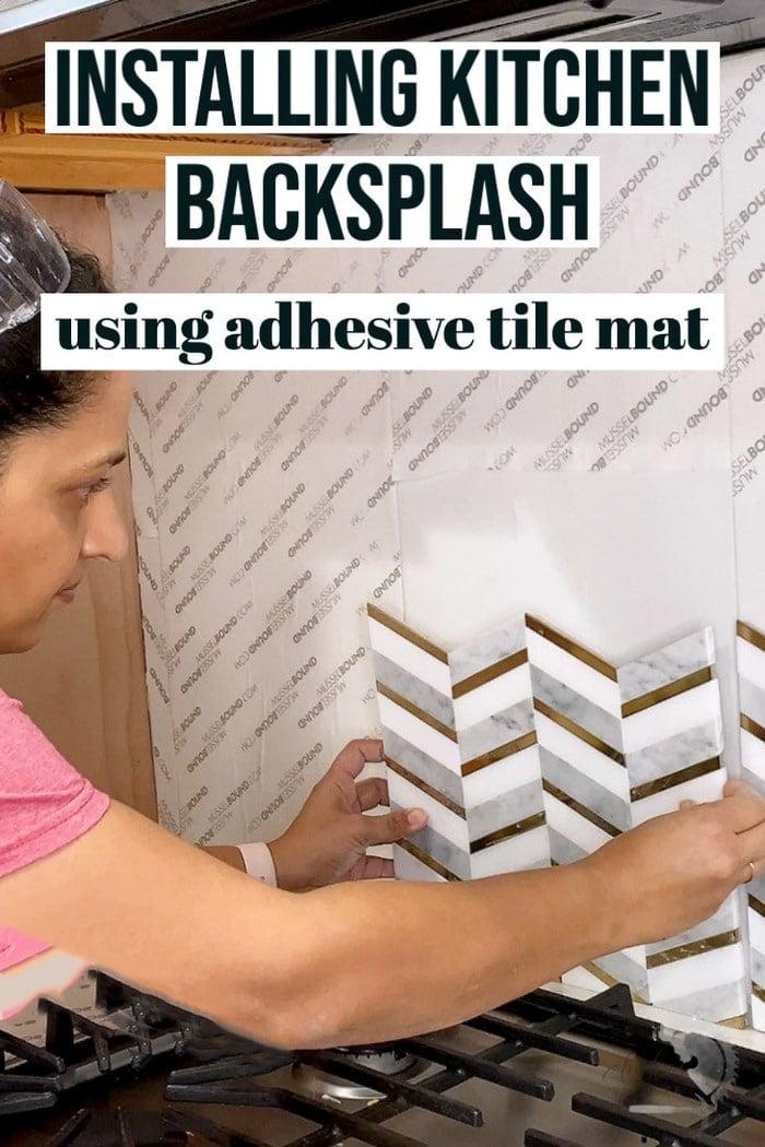 Woman applying mosaic tile to adhesive tile mat for  kitchen backsplash