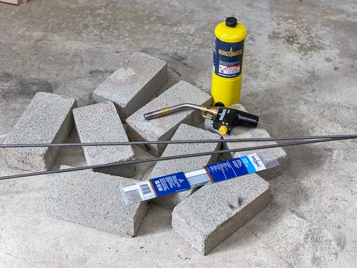 cement bricks and brazing equipment on garage floor