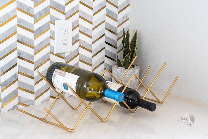 gold  DIY metal wine rack on kitchen countertop