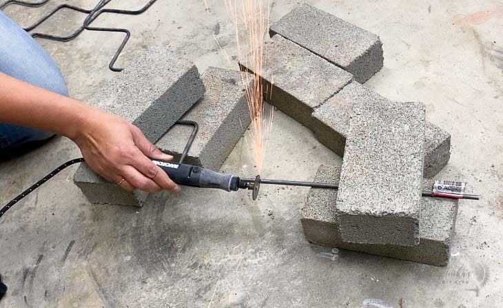 Cutting the steel rod using a rotary tool