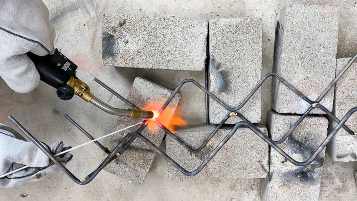Brazing steel rods to make the two tier wine bottle rack