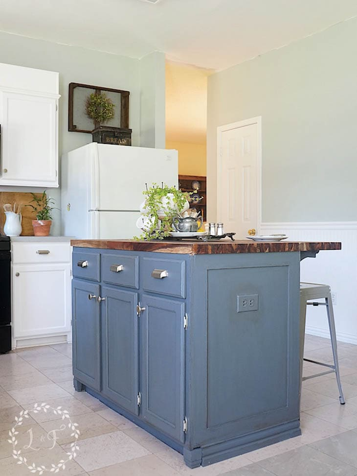 blue kitchen island with custom trim end panel