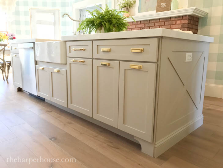 large kitchen island with wood X-trim panel on the end