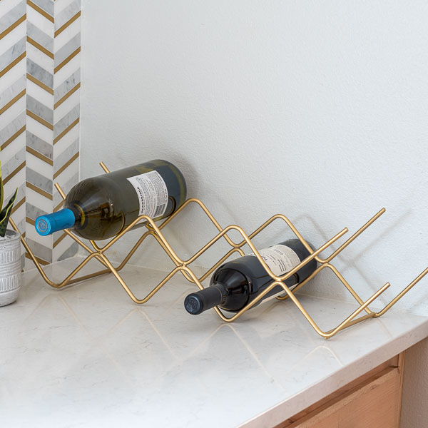Learn how to make a tabletop DIY wine rack using steel rods - no welding needed!