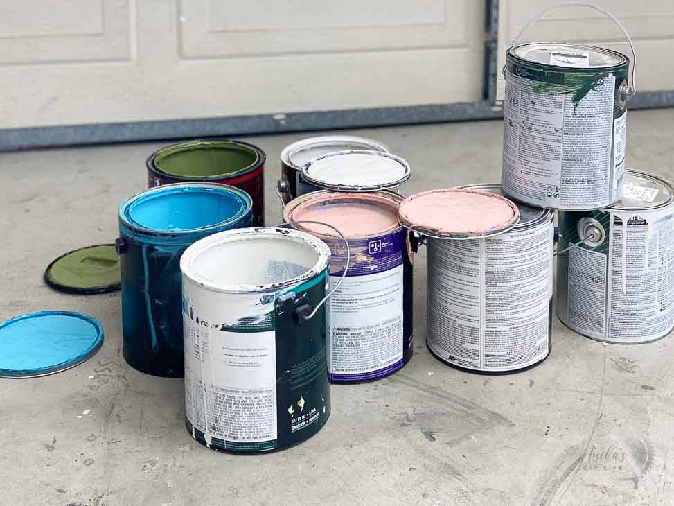 paint cans on garage floor