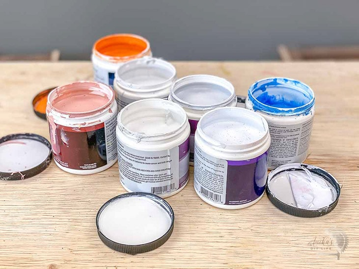 set of paint sample posts on a workbench