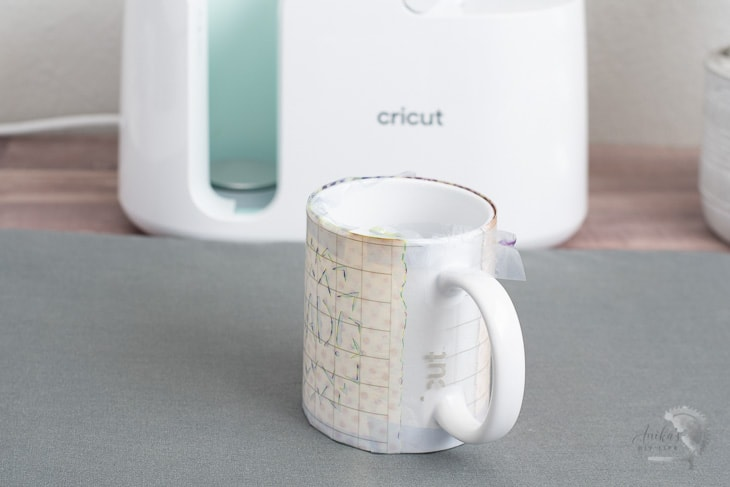 Mug cooling after being made in the Cricut MugPress
