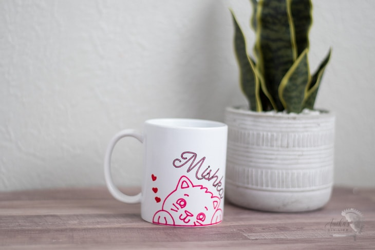 Cricut mug made using infusible ink markers on a table