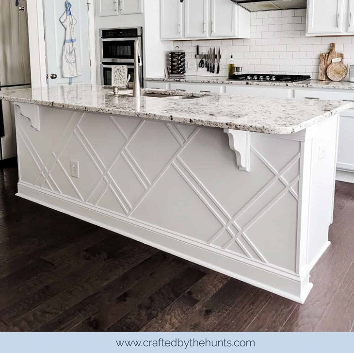 close up of white kitchen island update using trim in a geometric pattern.