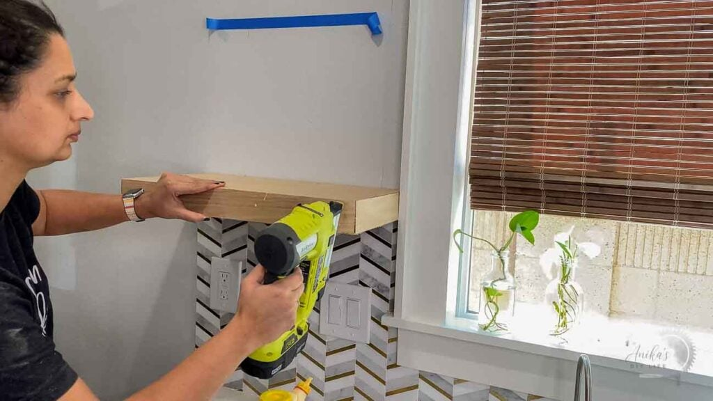 Attaching plywood to build a floating shelf in the kitchen