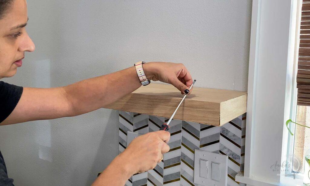 Rubbing screwdriver over seams to make them perfect