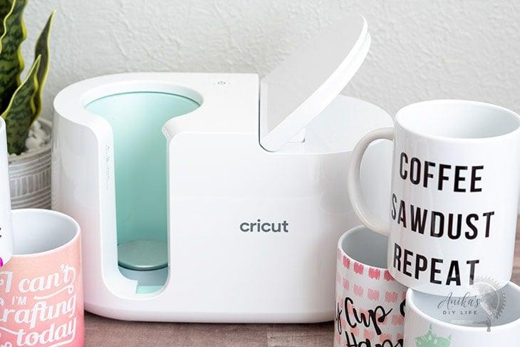 Cricut MugPress on table with mugs around it.