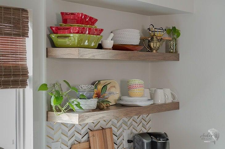 Long DIY floating shelves in a kitchen