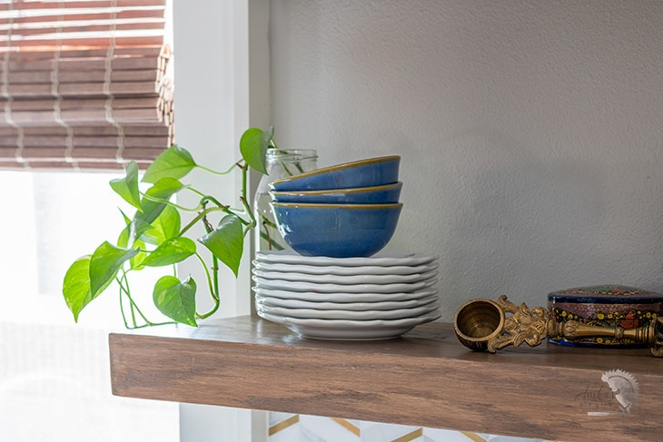 DIY gloating wood shelves in a kitchen