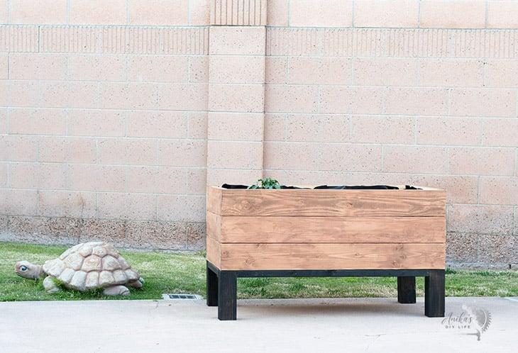 Simple DIY self watering planter box in backyard