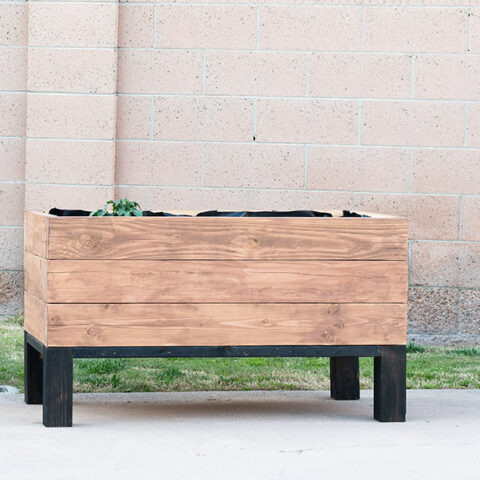 Learn exactly how to build a DIY self watering planter box. This sub-irrigation modern raised planter is perfect for any yard!