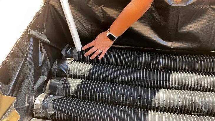 Adding the PVC pipe to one of the corrugated perforated pipes