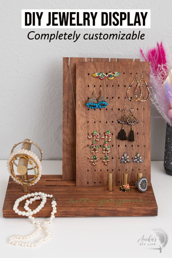 DIY Jewelry holder with jewelry on a table with text overlay